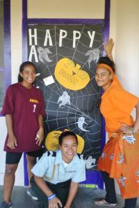 Three of my girls in front of my door, which they decorated for a spirit week competition.